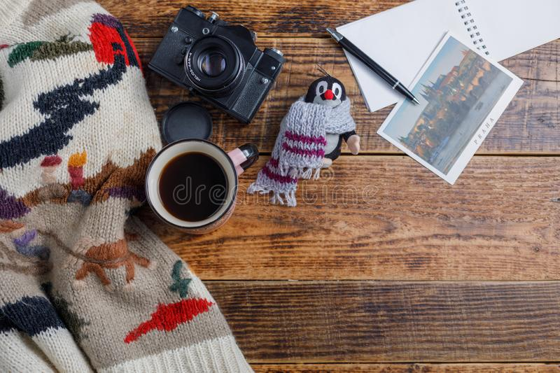 Different things for travel on a wooden background. Soviet retro camera and postcard Czech Republic and a cup of coffee. Flat lay royalty free stock photo