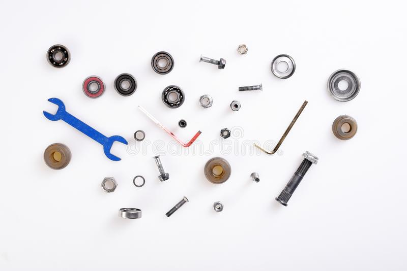 Different tools, bolts, bearings on white background royalty free stock photography