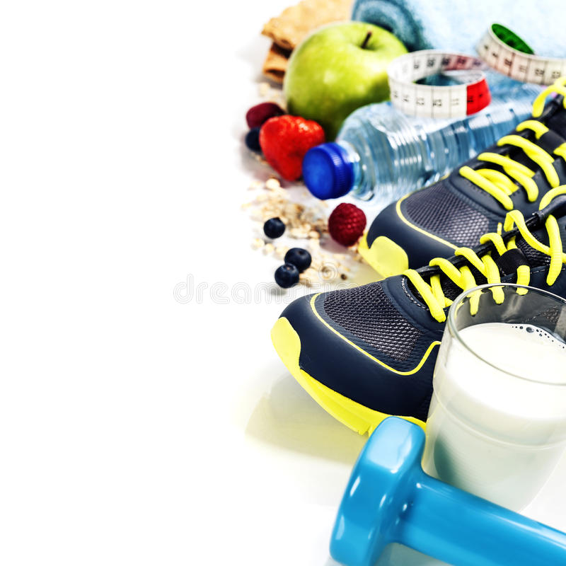 Different tools for sport and healthy food royalty free stock images