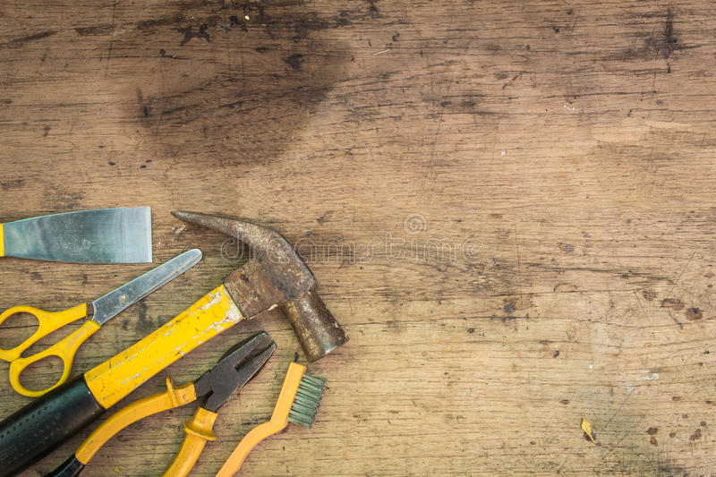 Different tools supplies on a wooden background stock photography