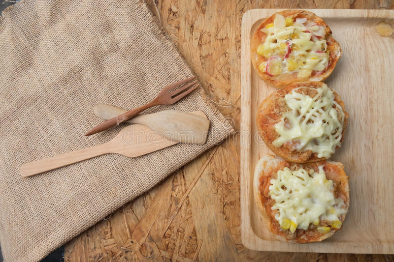 Different topped mini pizza buns. With mayonnaise sauce royalty free stock photography