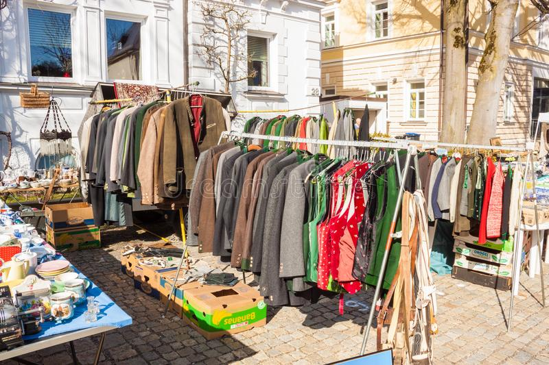 Different traditional bavarian clothes for sale on an outdoor flea market. Traunstein, Germany - April 8, 2018: Traditional bavarian clothes for sale on an royalty free stock images