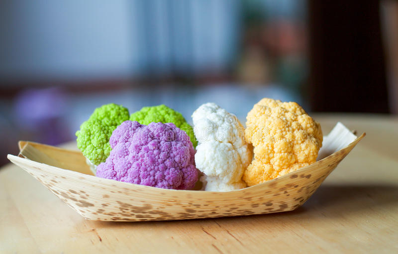 Different type of cauliflowers in a bamboo bowl royalty free stock photo