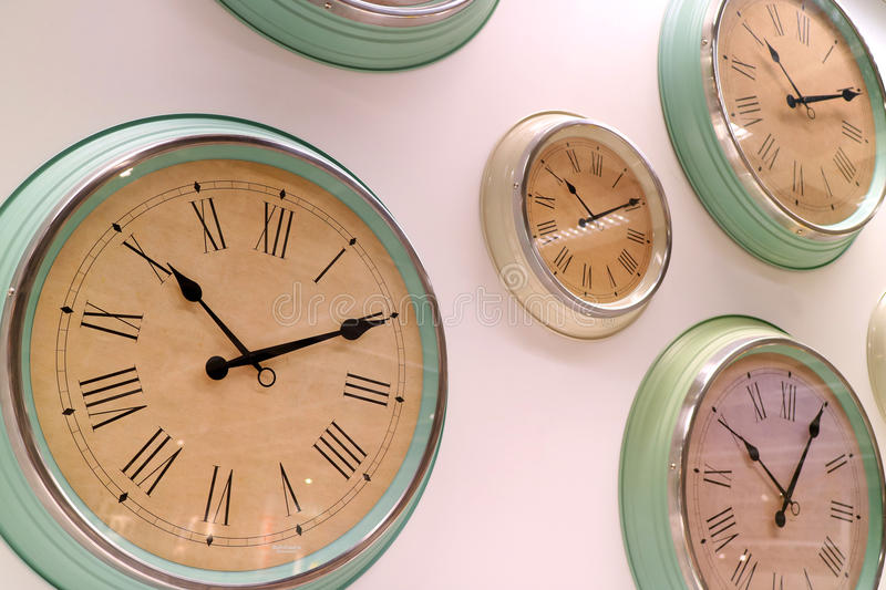 Different type of retro style wall clocks on the wall royalty free stock image
