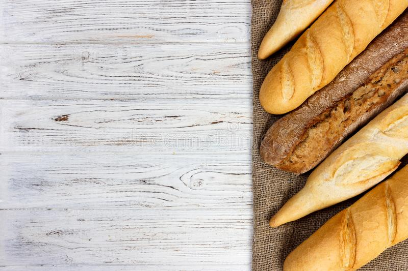 different types of baguette on a wooden background stock image