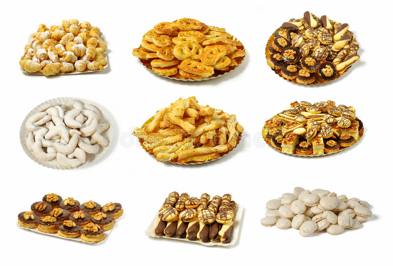 Different types of baked goods. Array of nine groups of different types of sweet and salty baked goods, arranged on plates, on a white background royalty free stock photography