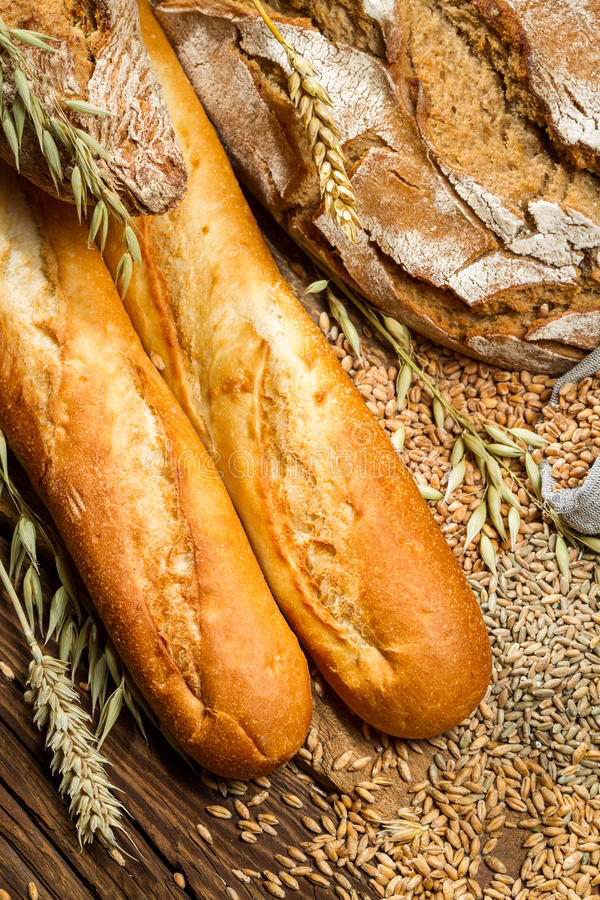 Different types of bread with ears grain royalty free stock image