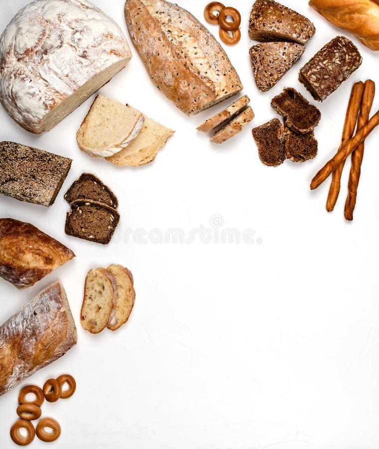 Different types of bread on a white background. Top view. Copy space. royalty free stock photos