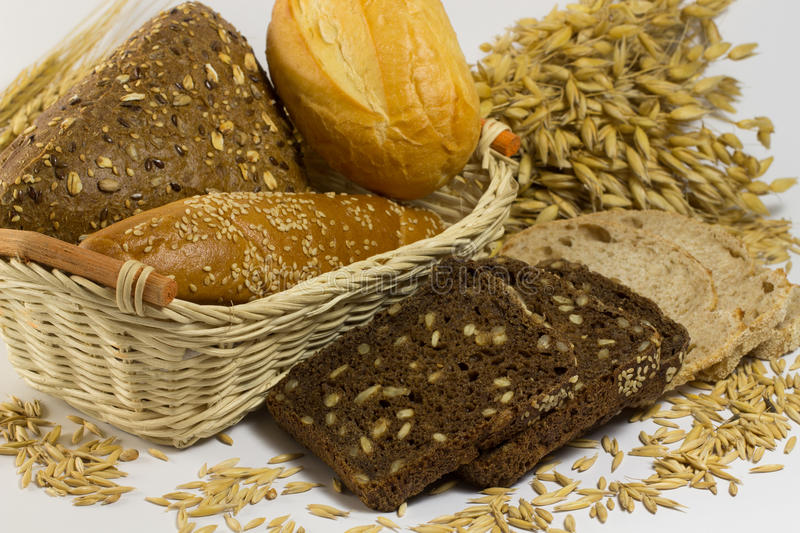 Different types of bread: white and black with seeds, baguettes royalty free stock photo