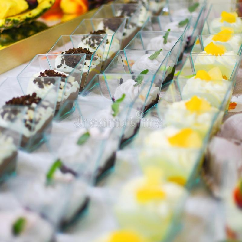 Different types of buffet dessert placed on table. Delicious restaurant raut concept. royalty free stock image