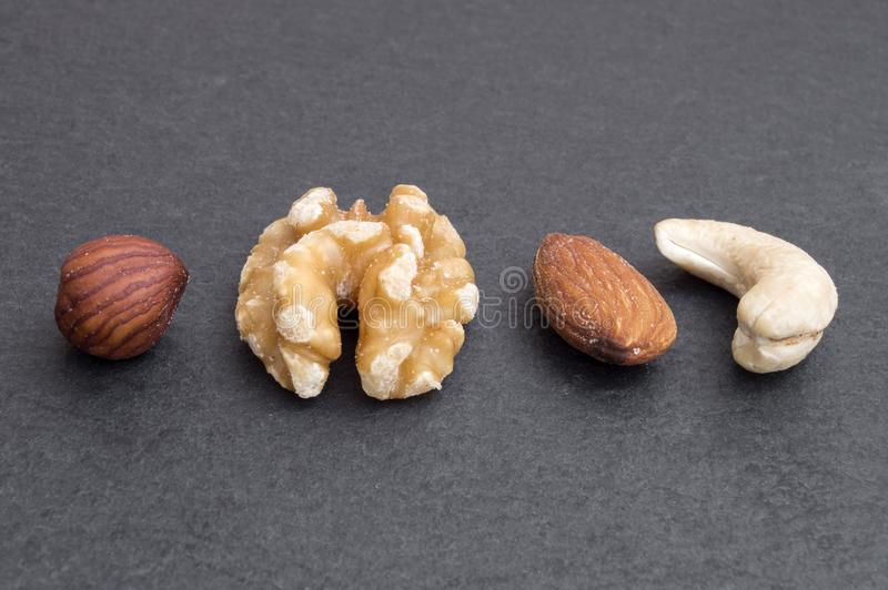different types of nuts, hazelnut, walnut, almond and cashew royalty free stock image