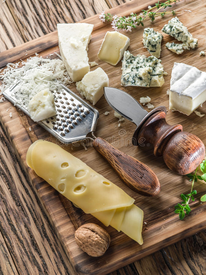 Different types of cheeses with nuts and herbs. Top view royalty free stock photography