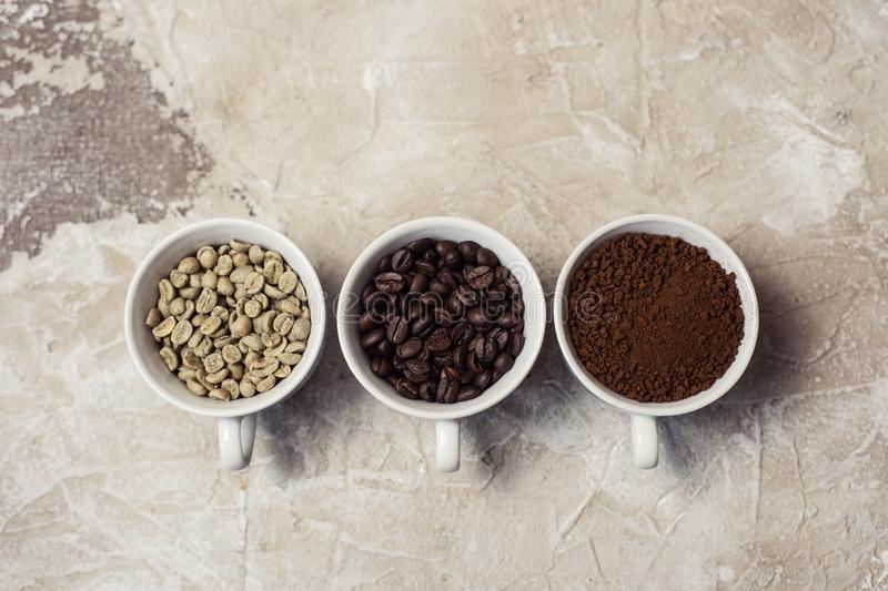 Different types of coffee - ground, grain and unroasted stock photography