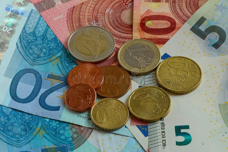 Different types of coins and banknotes of currency of European Union stock image