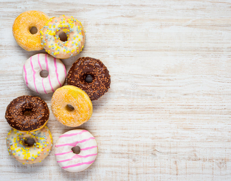 Different Types of Donuts on Copy Space. Copy Space Area and Different Types and Colors of Donuts stock image