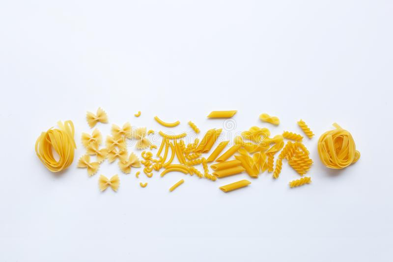 Different types of dry pasta on white royalty free stock photos