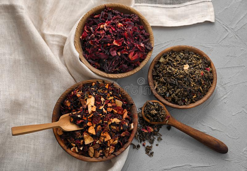Different types of dry tea leaves on table royalty free stock photography