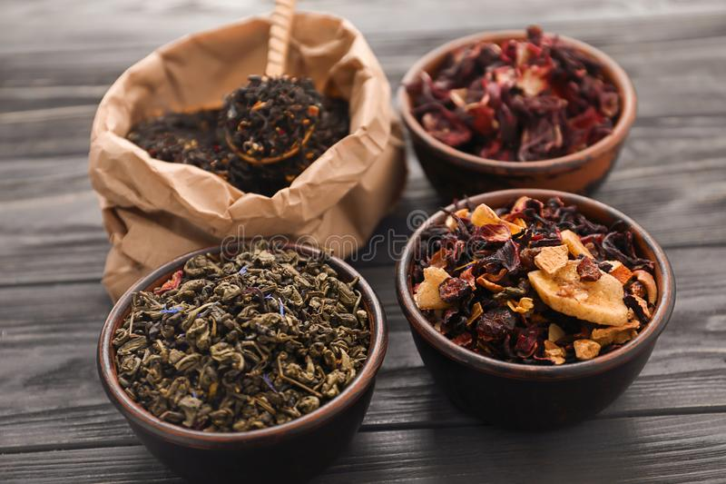 Different types of dry tea leaves on table royalty free stock photo