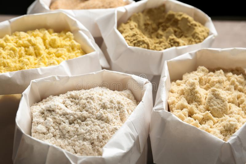 Different types of flour. In paper bags royalty free stock images