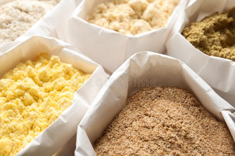 Different types of flour. In paper bags royalty free stock image