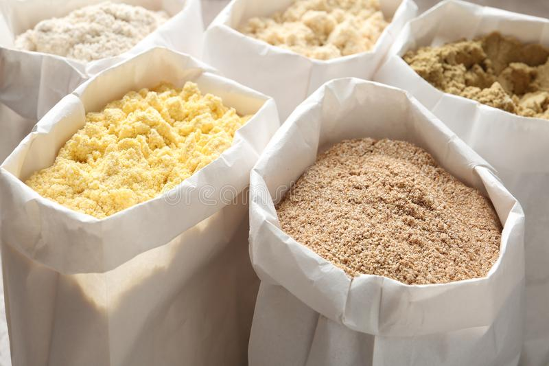 Different types of flour. In paper bags stock photo