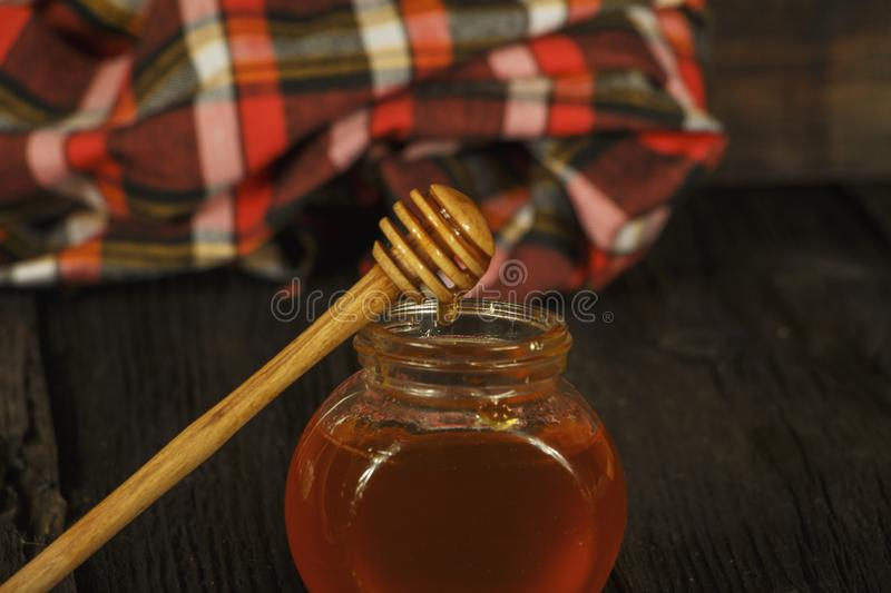 Different types of honey in glass jar on wooden rustic background. Honey in a glass jar. Honey is a healthy diet. stock photography