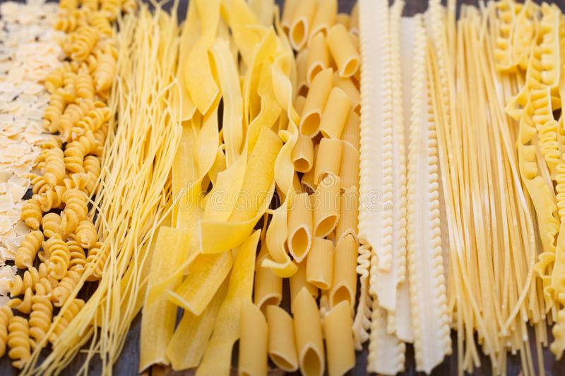 Different types of pasta, soup noodles and spaghetti. stock photos