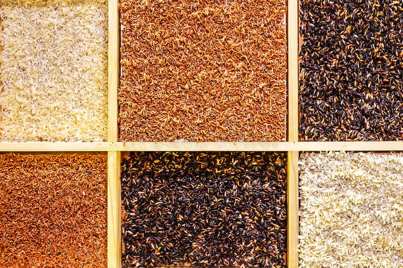 Different types of rice as background stock images