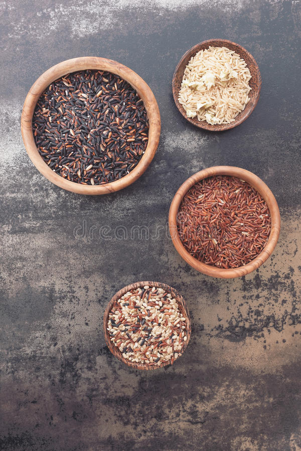 Different types of rice in small bowls stock image