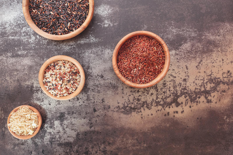 Different types of rice in small bowls royalty free stock photography