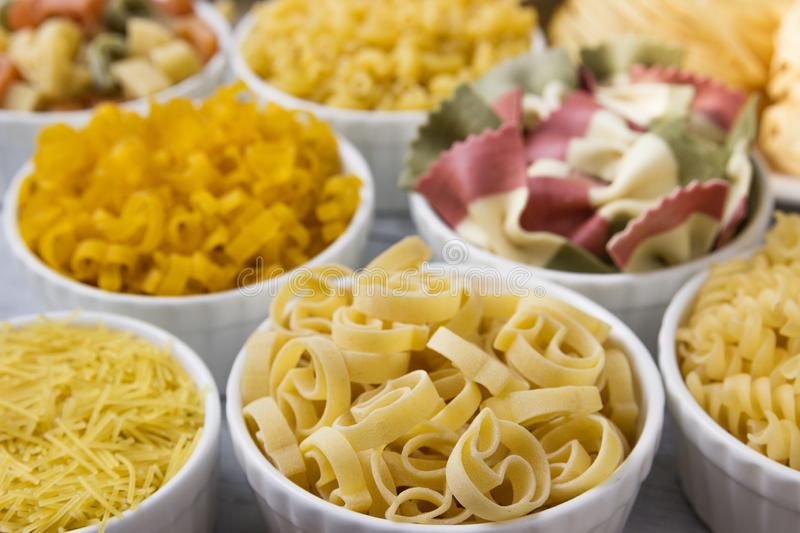 Different of types and shapes of dry Italian  of pasta stock images