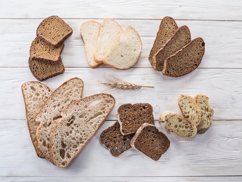 Different types of sliced bread. Different types of sliced bread on wooden table stock photography