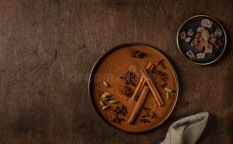 Different types of spices, cardamom, cinnamon, cloves, star anise and caramel sugar royalty free stock photography