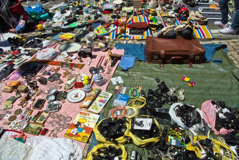 Lisbon, Portugal - May 4, 2013 Flea market goods on a ground. Different unsorted goods on a ground in the flea market of Lisbon Portugal stock photos