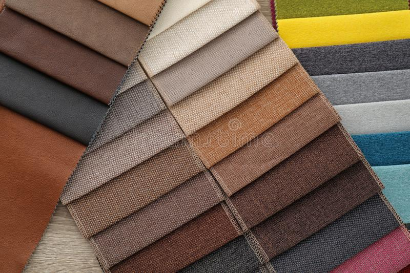Different upholstery fabric samples, closeup. Interior design royalty free stock image