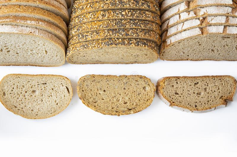Different varieties of bread cut into slices on a white background .isolated. Objects royalty free stock photography