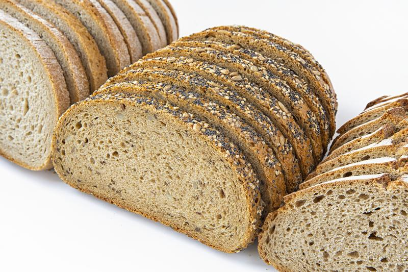 Different varieties of bread cut into slices on a white background .isolated objects. Different varieties of bread cut into slices on a white background .objects stock photos