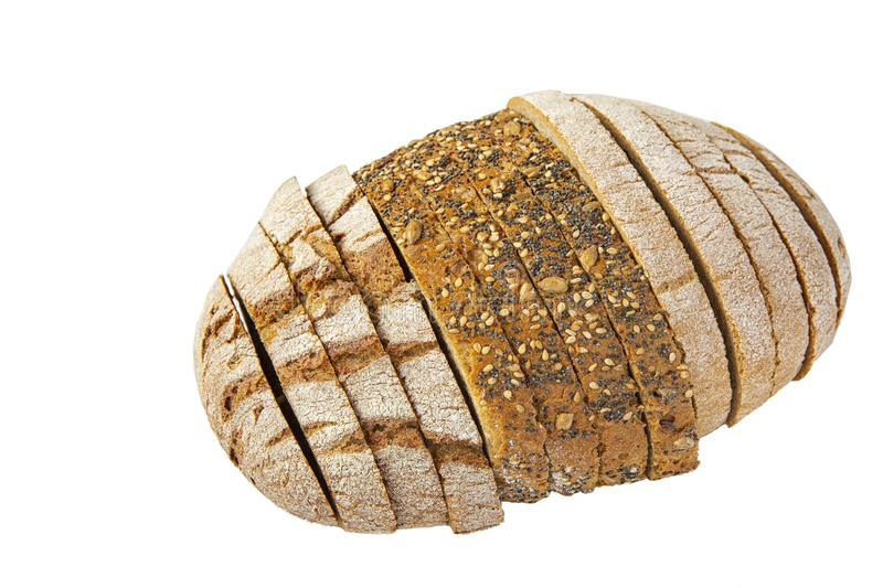 Different varieties of bread cut into slices on a white background .isolated objects. Different varieties of bread cut into slices on a white background stock photos