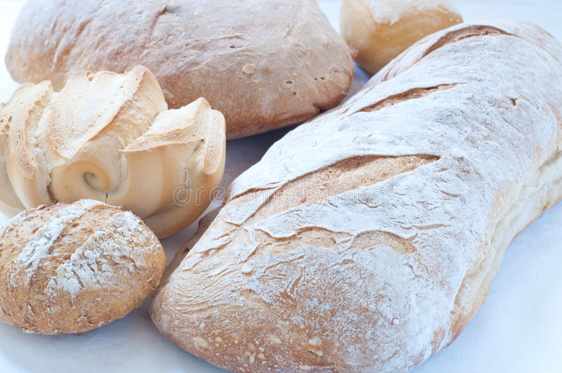 Different varieties of Italian pasta and homemade bread royalty free stock image