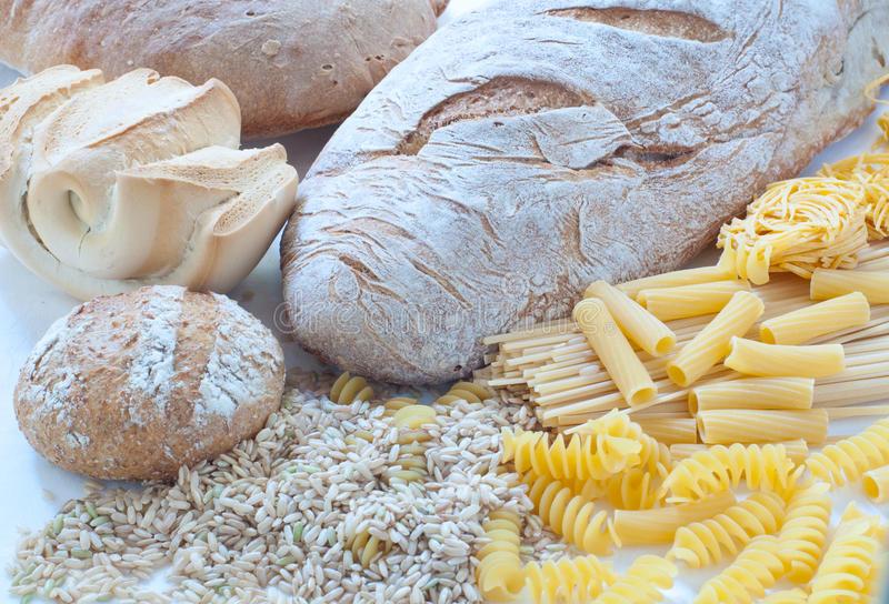 Different varieties of Italian pasta and homemade bread royalty free stock photos