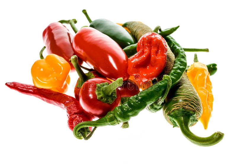 Different variety of hot peppers or chilies, isolated on white. Different variety of hot peppers - a bunch of chilies, isolated on white. Hot pepper Macedonian stock photography
