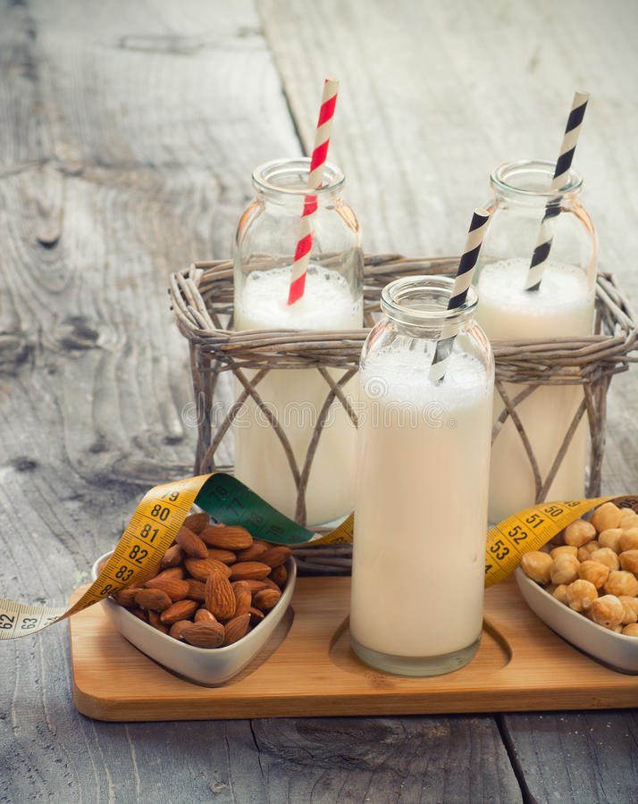 Different vegan milks on a table. Substitute for dairy milk stock photography