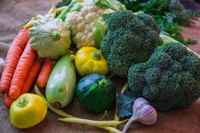 Different vegetables, small patissons, along with other vegetables, cauliflower, broccoli, garlic, cucumbers grown on an eco-farm.  stock photo