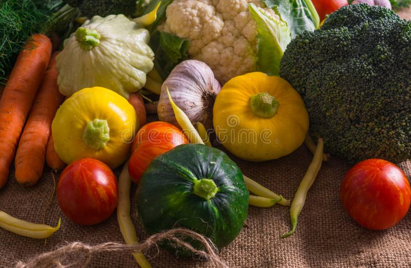 Different vegetables, small patissons, along with other vegetables, cauliflower, broccoli, garlic, cucumbers grown on an eco-farm.  royalty free stock photo