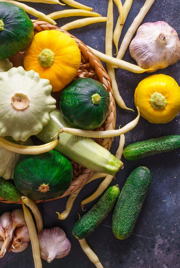 Different vegetables, small patissons, along with other vegetables, cauliflower, broccoli, garlic, cucumbers grown on an eco-farm.  stock photos
