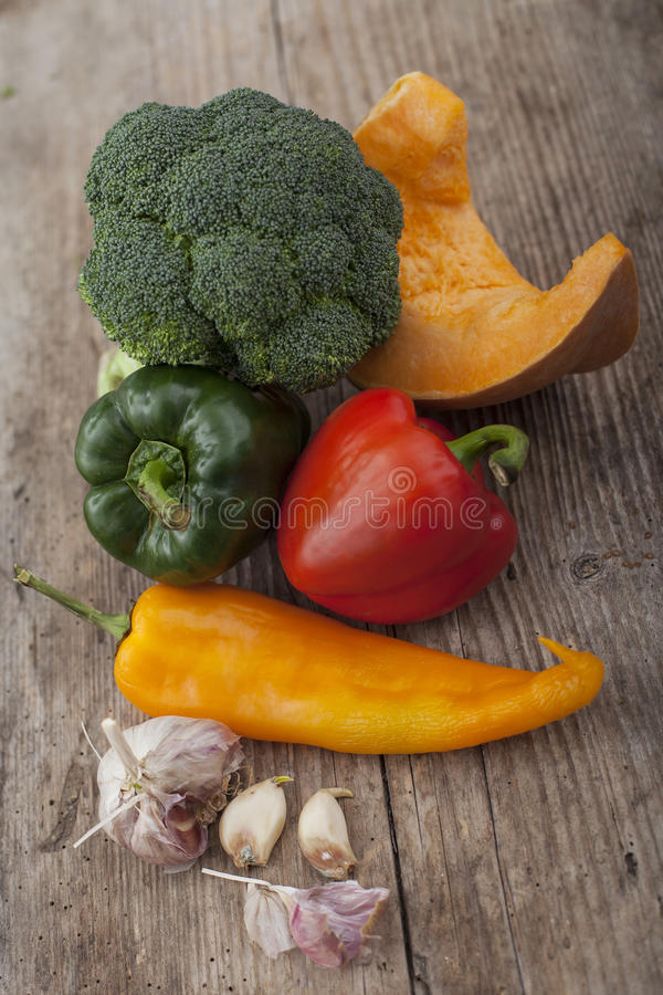 Different vegetables on wooden surface. Different colorful vegetables on wooden surface royalty free stock photography