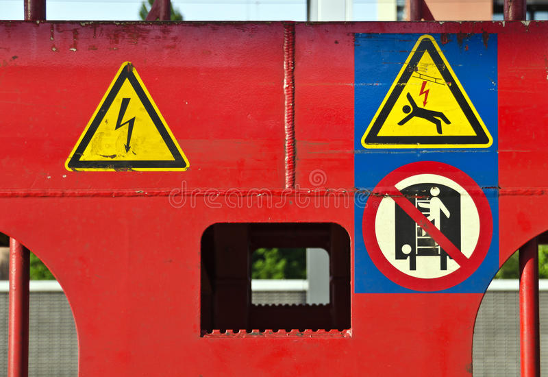 Different warning signs. At a red painted train waggon royalty free stock images