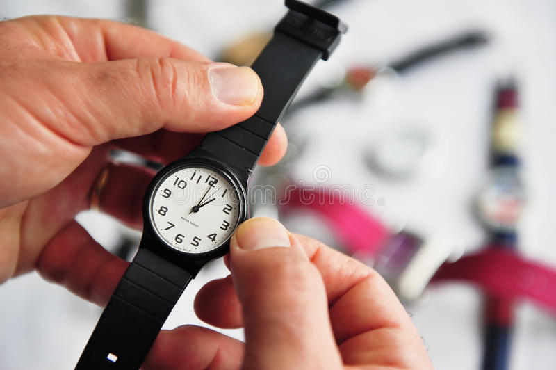 Man hands adjusting the time stock photos