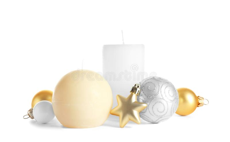 Different wax candles and Christmas decorations. On white background royalty free stock photography