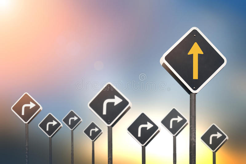 Different way concept by go straight yellow arrow. Traffic sign and many turn right traffic sign royalty free stock photography